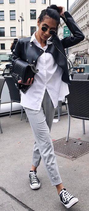 Camicia bianca e chiodo di pelle