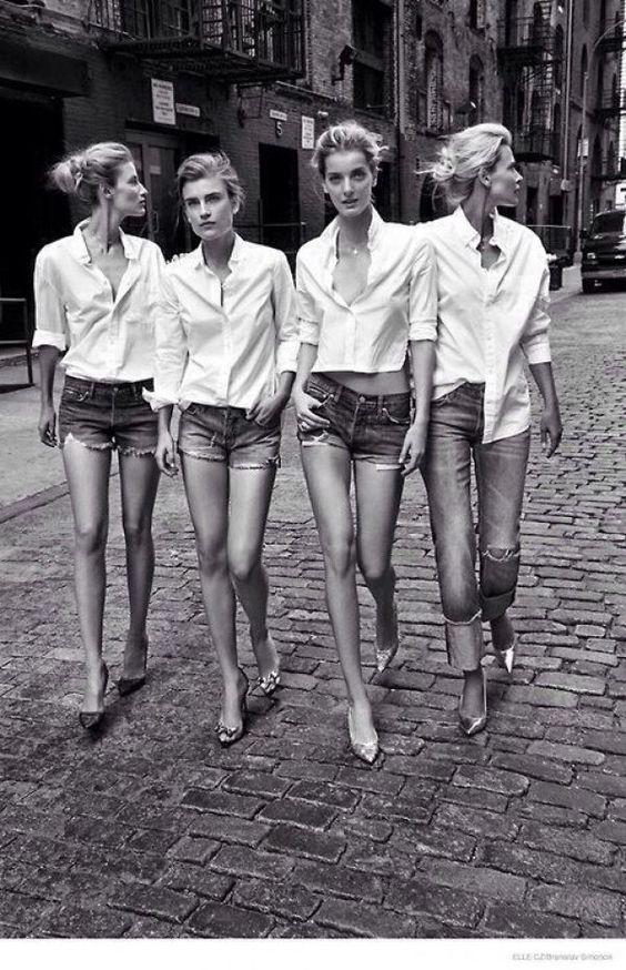 Top model in camicia bianca