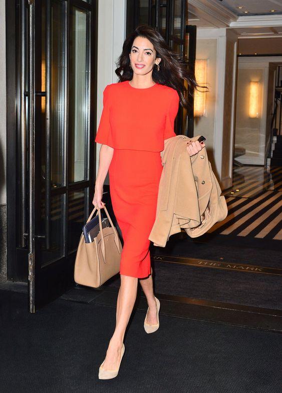 Amal Clooney in an orange dress